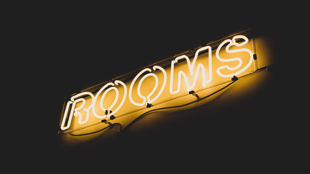 Rooms Neon Yellow Sign
